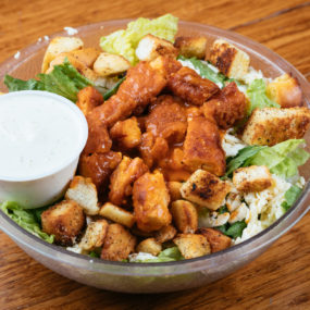 Buffalo chicken salad tossed with romaine, ranch, pepper jack cheese, and croutons.