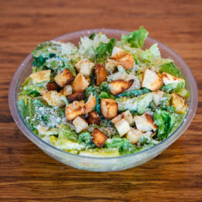 Caesar salad with romaine lettuce tossed with caesar, croutons and parmesan cheese.