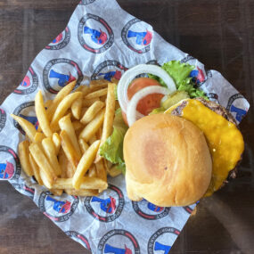 Cheeseburger with fries on The Post Sports Bar & Grill sheet paper