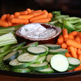 Veggie Catering Tray with Baby carrots, celery, cucumber, and green pepper and a French onion dip