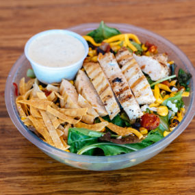 Southwest Salad with Grilled chicken, mixed greens, black bean & corn salsa, cheddar jack & tortilla chips.  Served w/jalapeno ranch