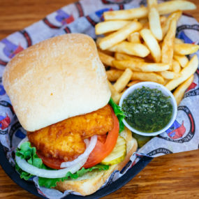 Cod fish filet sandwich with lettuce, tomato & onion on a toasted ciabatta. Served with homemade chimichurri sauce and fries