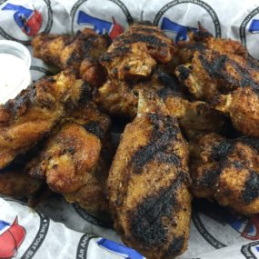 Memphis Wings Appetizer consisting of charbroiled and gently coated in a homemade Memphis-style rub and served with ranch