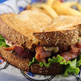 Boss BLT Sandwich with Bacon, lettuce, tomato and our homemade roasted tomato aioli Boss Sauce.  Served on toasted wheat bread