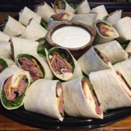 Roast Beef Wrap Catering Tray with lettuce, tomato, cheddar in a white tortilla. Served w/horseradish
