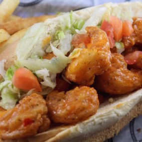 Shrimp Po Boy Sandwich tossed in bang bang sauce. Served on a toasted hoagie with lettuce and tomato