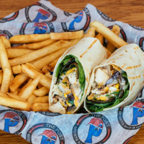 Southwest Wrap with Marinated chicken, spring mix, cheddar jack, & jalapeno ranch wrapped in a white tortilla. Served with fries