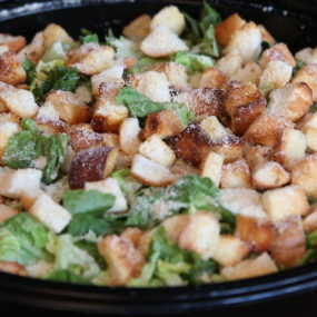 Caesar Salad Catering Tray with Romaine, croutons, parmesan cheese and caesar.