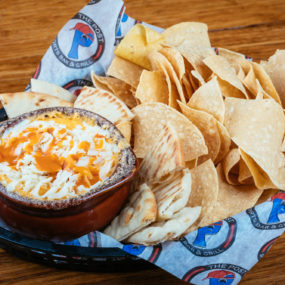Delicious 3 cheese Buffalo Chicken Dip Appetizer with warm pita points and tortilla chips