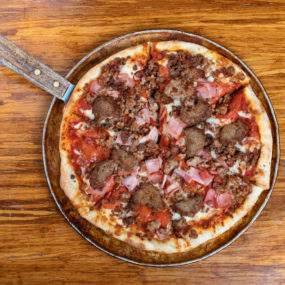 Deliciously meaty Meat Ragers pizza with Pepperoni, sausage, hamburger, bacon, ham and meatball.