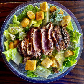 Blackened tuna with croutons lettuce and dressing
